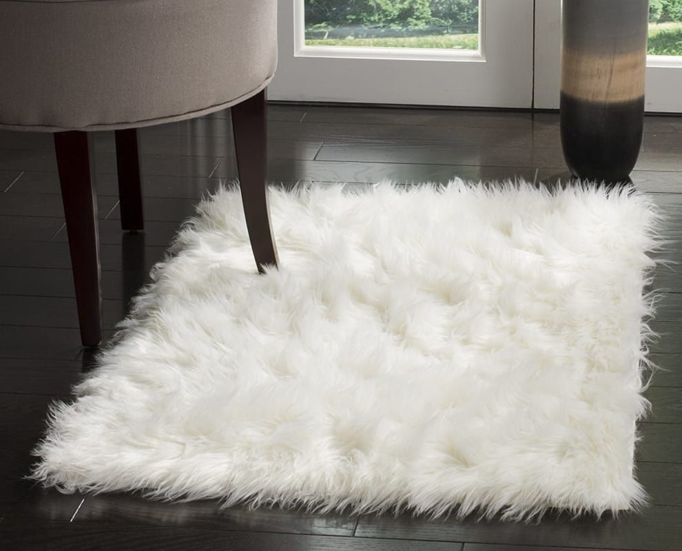 23 Cuddly Products You Are Going To Want To Hug As Soon As Possible Faux Sheepskin Rug Guest Bedroom Design Classic Rugs