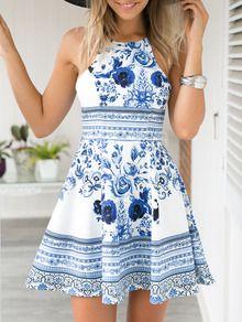 Photo of Blå blomstertrykk Spaghetti stropp skater kjole