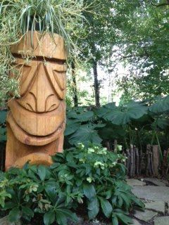 Sept. 21 - 5 ft. garden tiki with spider plant wig and Helebores still blooming?!