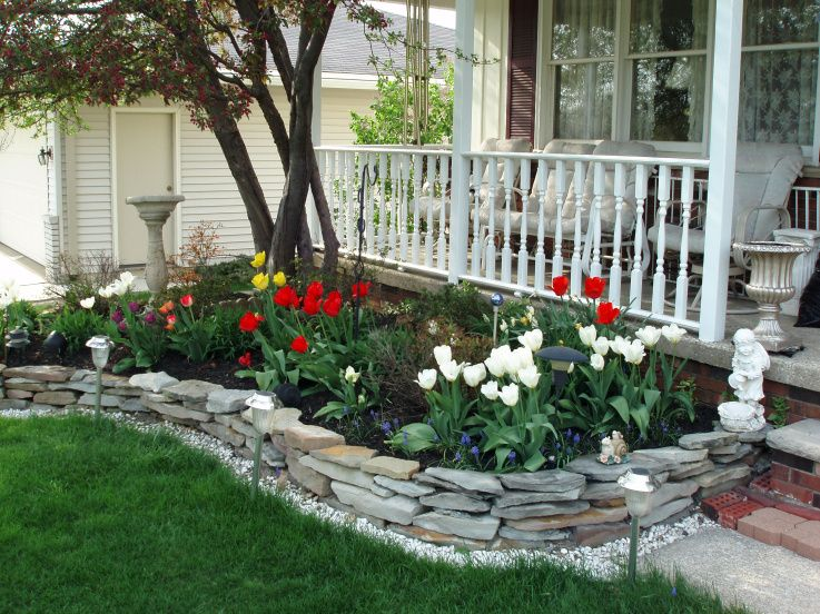 Did this stone wall on one side in front already trying for Front yard flower bed designs
