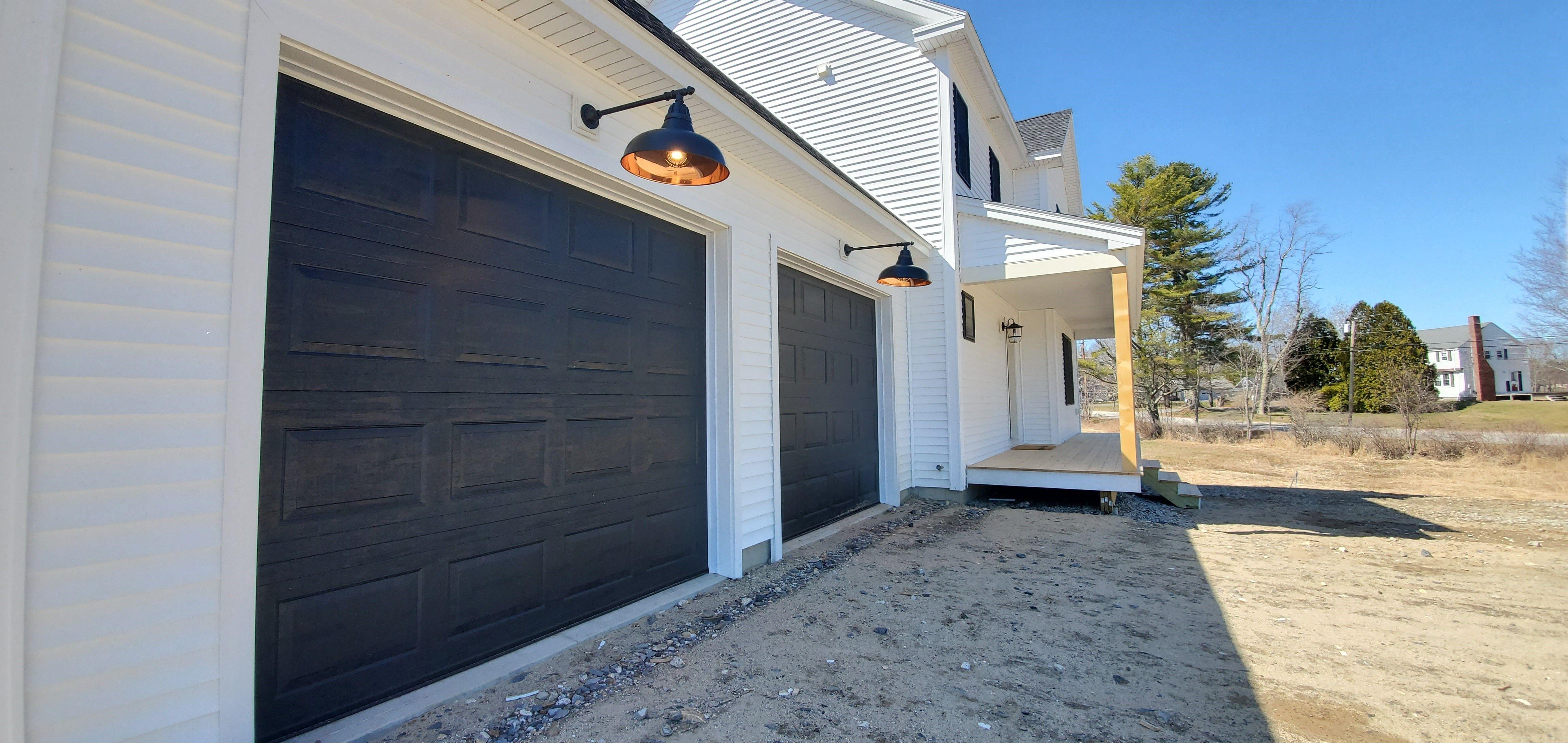 Black garage doors in 2020 modern farmhouse garage