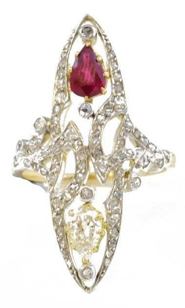 Art Nouveau Ruby and Diamond Ring. A long navette shaped ring, set with diamonds throughout and a principle pear shape diamond and ruby at opposite ends. Mounted in platinum and 18 ct yellow gold. English, circa 1905.
