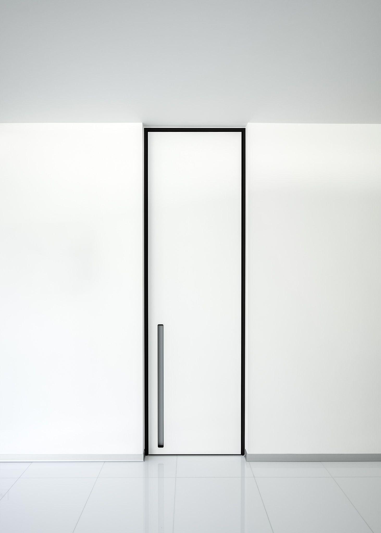 Modern White Interior Door With A Black Door Frame And Vertical Built In Handle By Anywaydoors White Interior Doors Doors Interior Glass Doors Interior