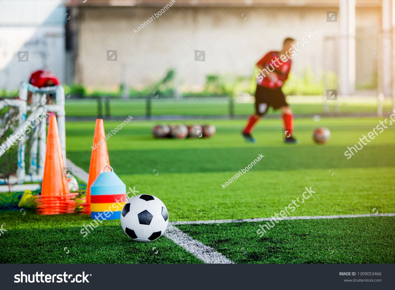 Football And Soccer Training Equipment On Green Artificial Turf With Blurry Of Soccer Players Training Soccer Training Equipment Soccer Training Soccer Academy