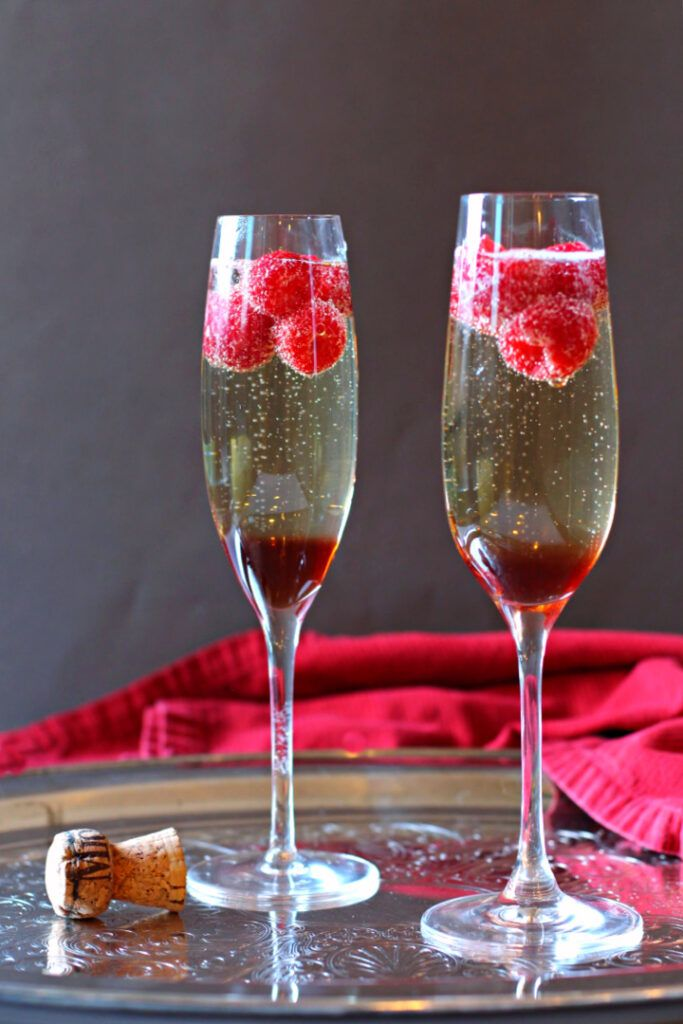 Prosecco cocktail made with Chambord Raspberry Liqueur and fresh raspberries.
