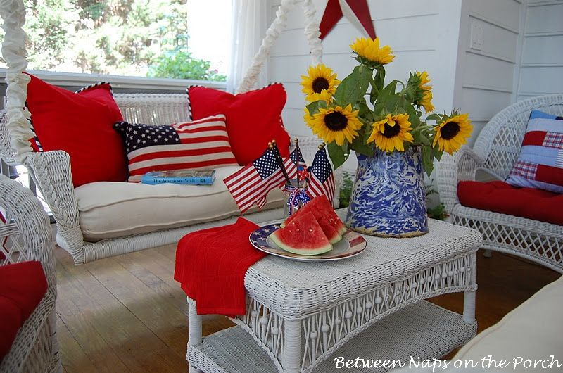Screened-in Porch Decorated for the 4th of July...love the sunflowers with all the red, white, and blue.