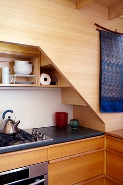 Kitchen Tucked Under Staircase In A Tiny House To Connect With