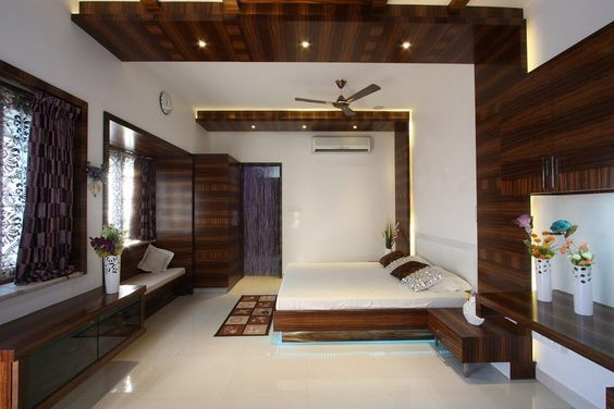 Wooden Wall Panelling Turns Into False Ceiling To Give A Dramatic Look To The Bedroom Bedroom False Ceiling Design Wooden Bed Design Ceiling Design Modern