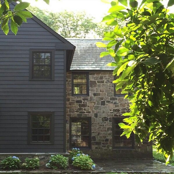 Grey colour stone black windows our dream house for Black stone house