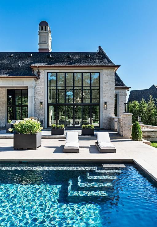 Photo of Stunning French style home with an in-ground rectangular pool features wicker po… – Architecture Designs