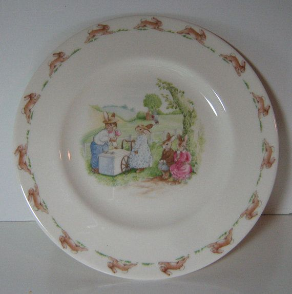 """A Beatrice Potter Bunnykins plate by Royal Doulton makes a great gift for the child in your life. Children's dinnerware great for baptisms or birthdays, it depicts a mother and her little bunnies buying ice cream under the shade of a tree on a hot summer's day. Clearly labelled """"English Fine Bone China"""", it is an 8"""" plate, and is vintage 1988. This adorable children's dish is in mint condition. Childrens Dishes Bunnykins Plate by Royal by TheMichiganAttic"""