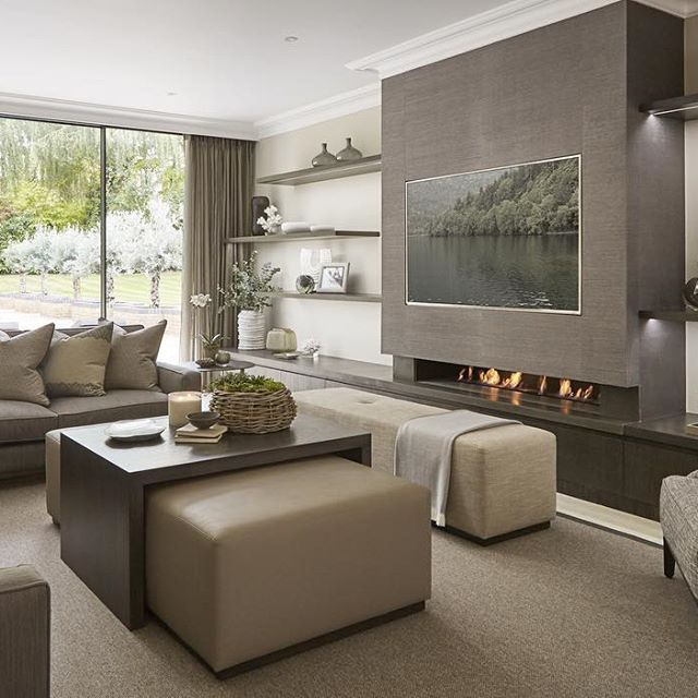 Very contemporary and neutral family room off the kitchen for Family room tv wall ideas