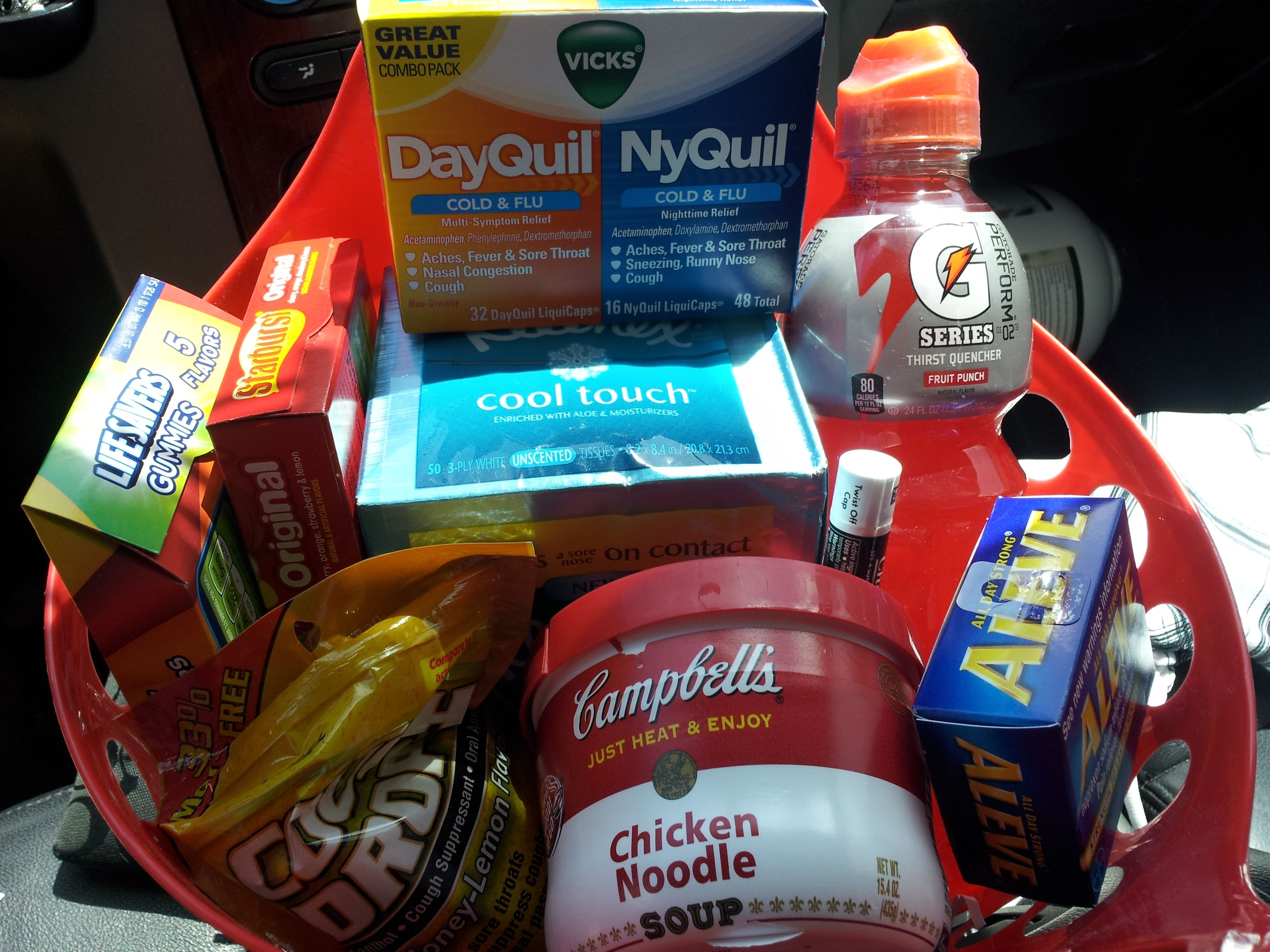 a get well basket for my sick love medicine,candy,drink,soup