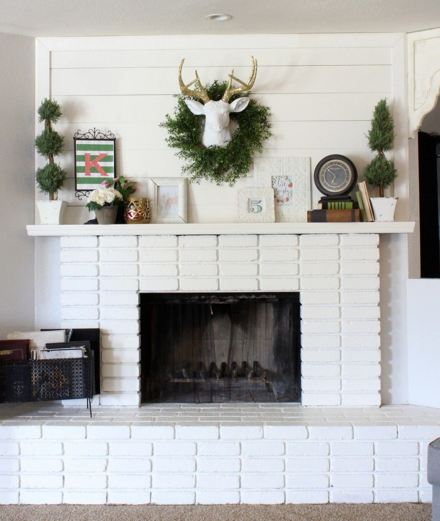 DIY Planked Mantle and White brick fireplace Brick