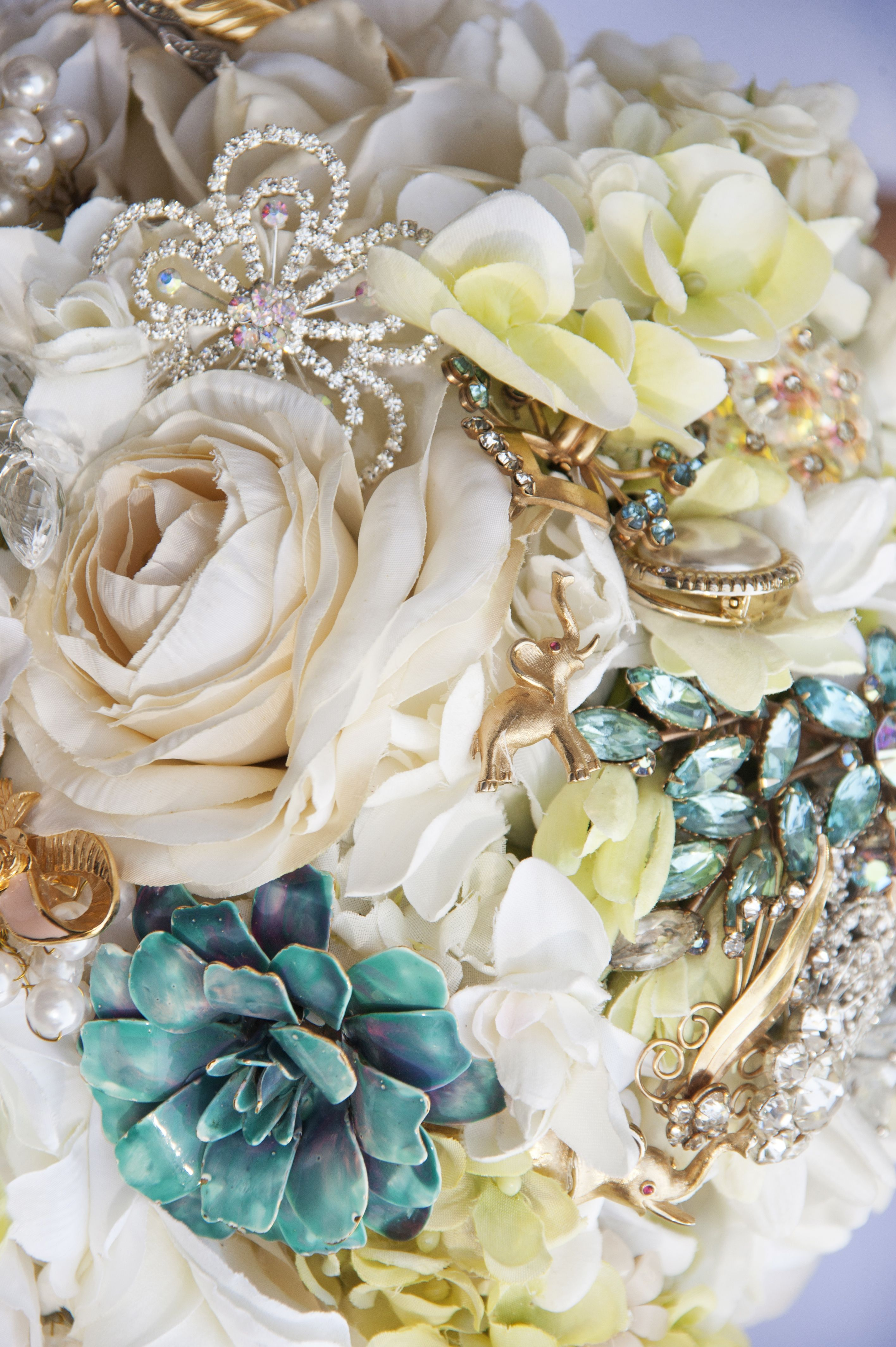 Close up of janines bridal bouquet with vintage brooches brooch close up of janines bridal bouquet with vintage brooches izmirmasajfo