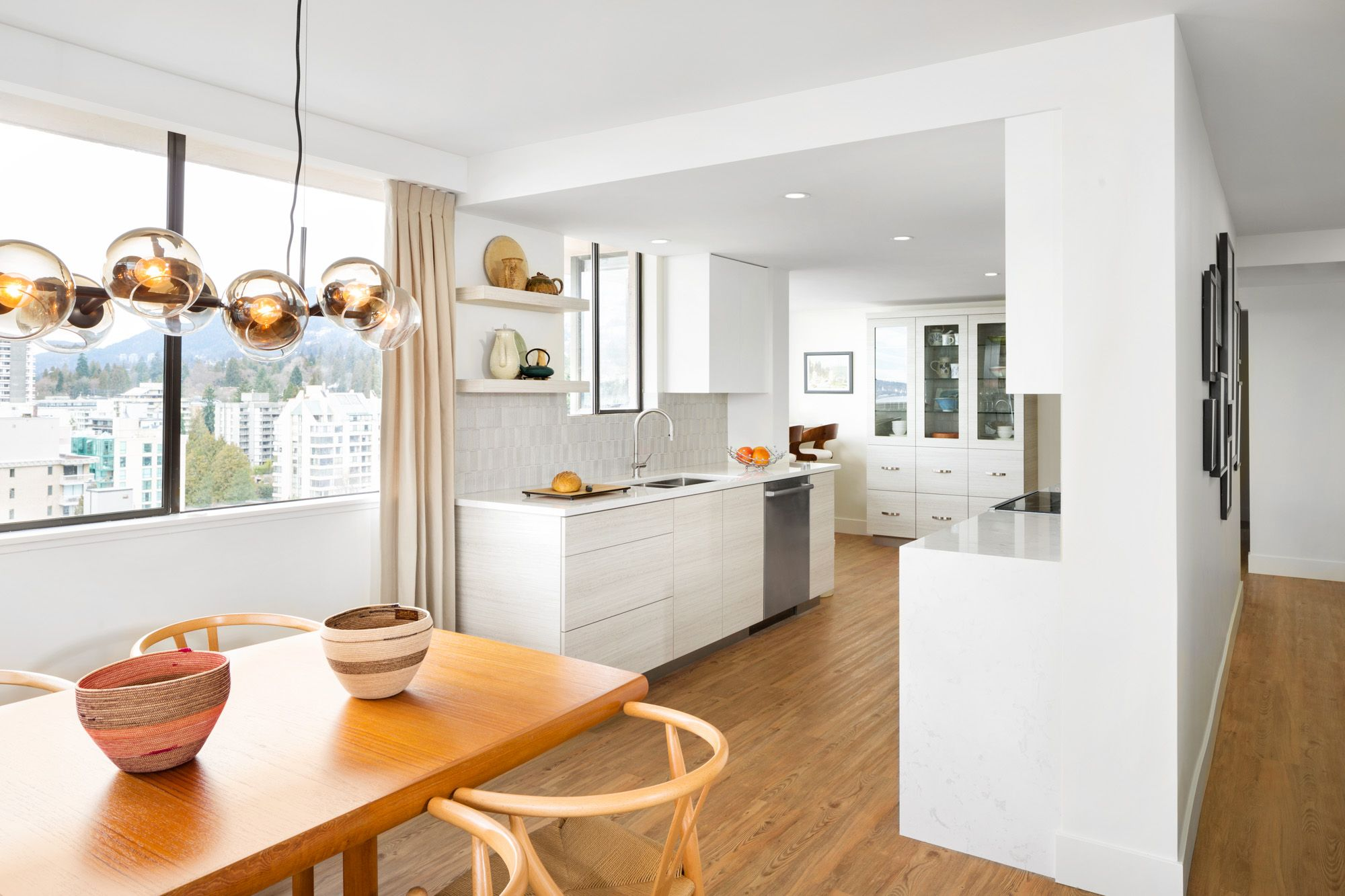 A bright, open-concept kitchen renovation with a mid-century modern ...