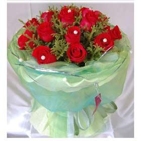 Know You  16 red roses, match greenery. White wavy paper to wrap inside, blue gauze wrap out side.
