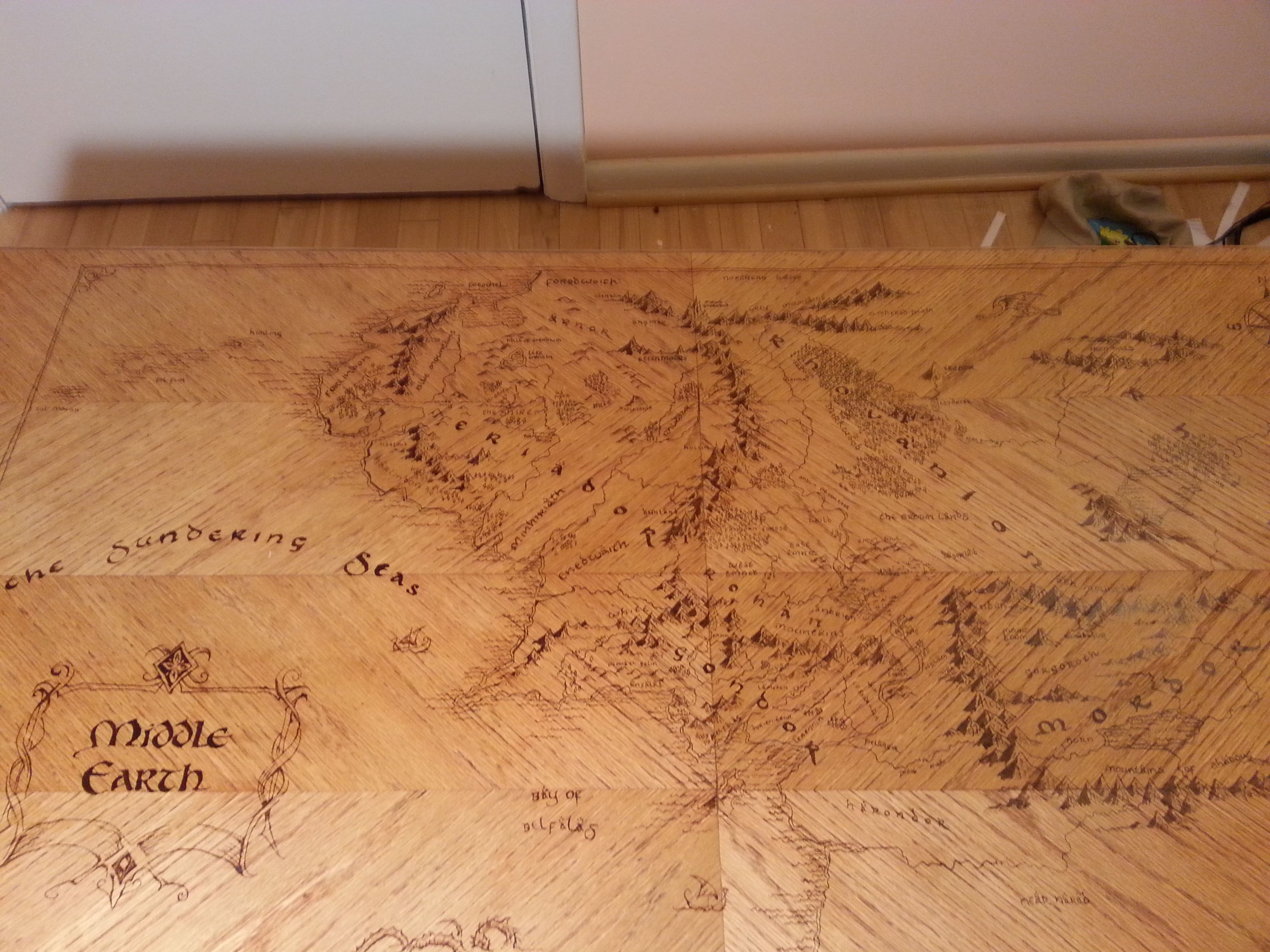 pyrography The Lord of The Rings map on old wooden coffee table