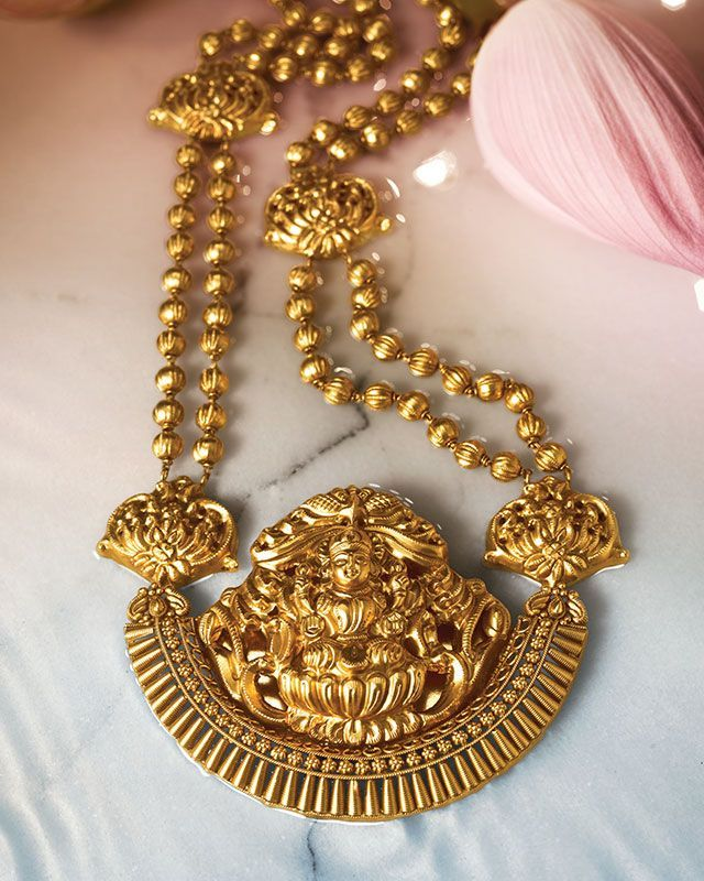 Statement necklace with lakshmi pendant by Tanishq. Gold ...