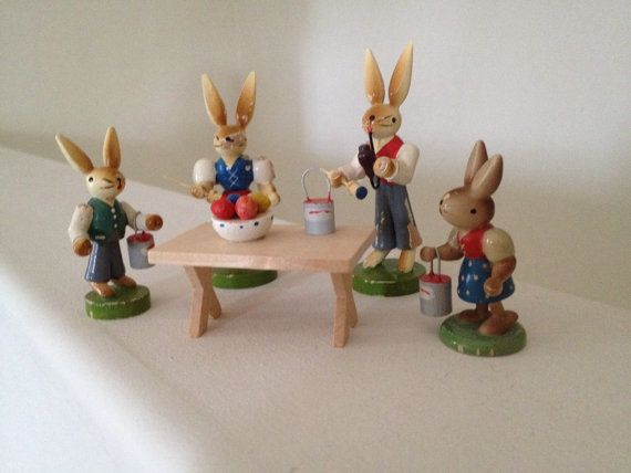 German Rabbit Family Decorating Easter Eggs by Diddyandcompany