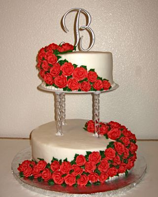 6 And 10 Round Pillared Cake Is Iced With Buttercream Icing