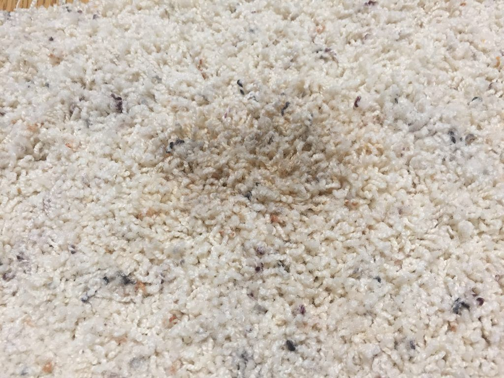 how to remove candle wax from carpet and upholstery