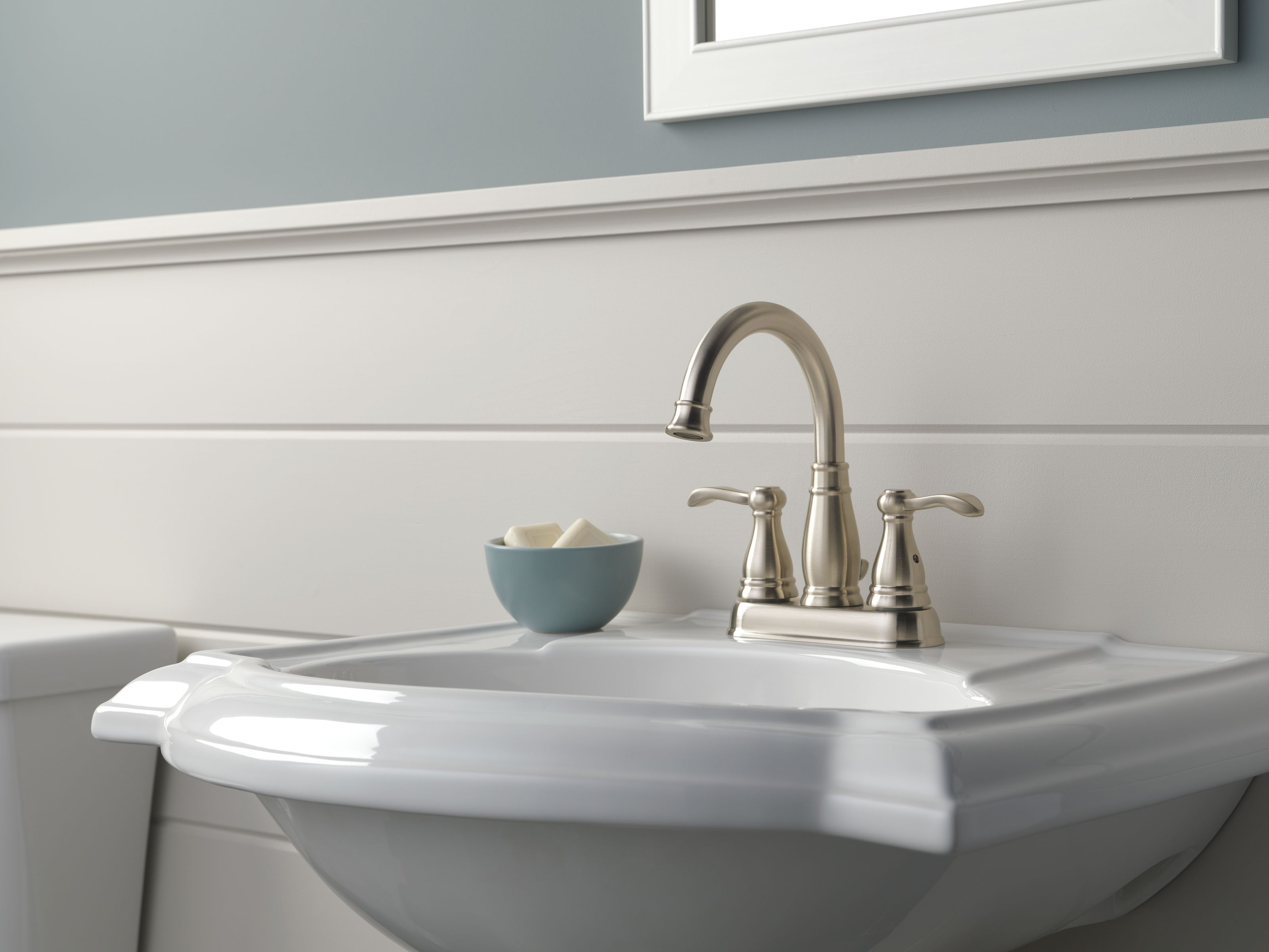 White Standing Pedestal Sink With Gorgeous Brushed Nickel Faucet