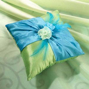 "WeddingDepot.com ~ Blue & Green Ring Bearer Pillow ~ This eye catching 7"" Blue/Green ring pillow is beautifully created with vibrant colors, feathers and two color-matched flowers affixed to the front."