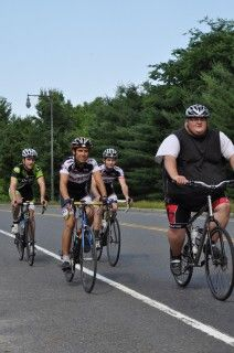 A Bicycle And A Few Friends Lead A Big Man Into An Even Bigger