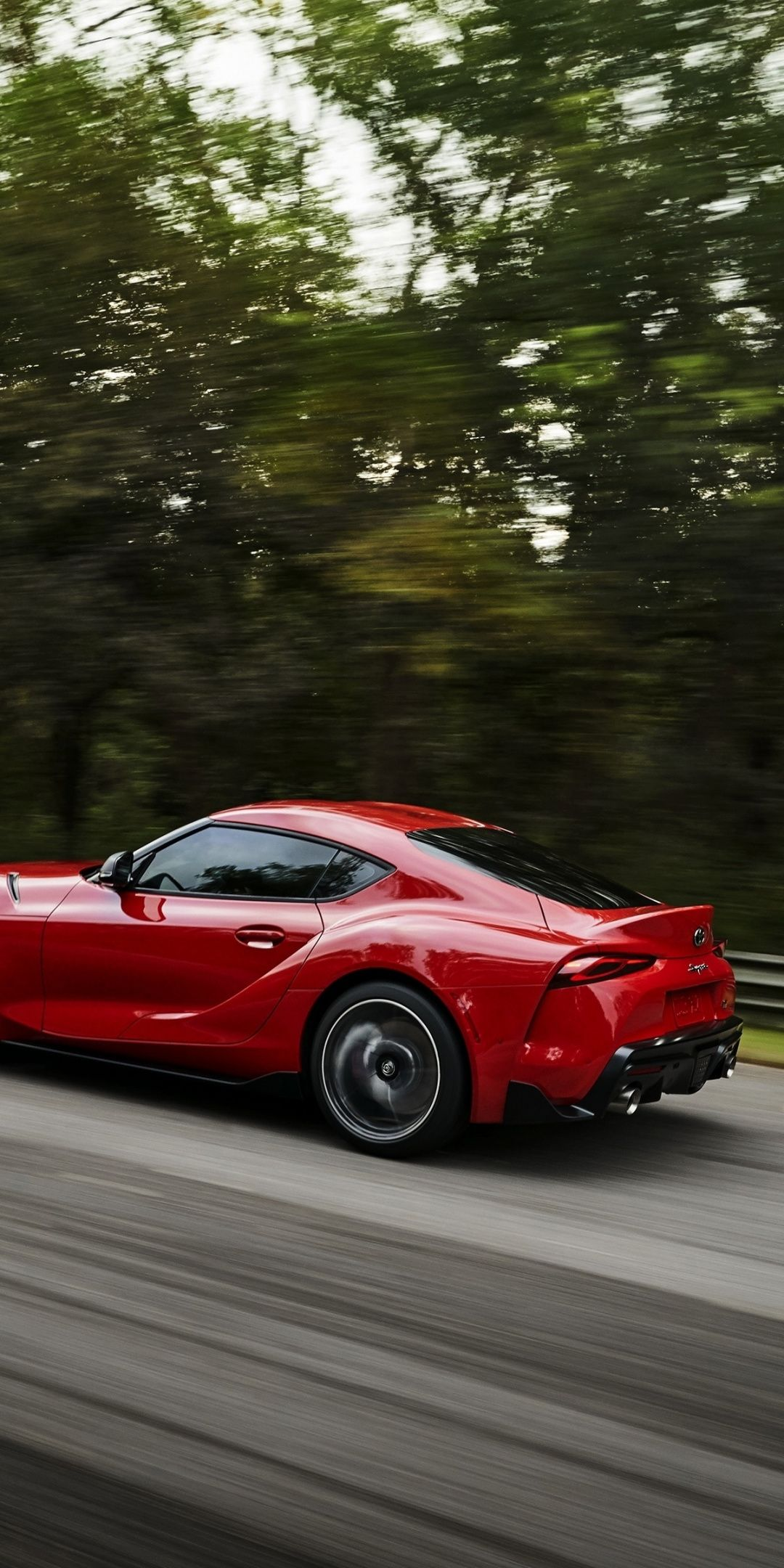 1080x2160 On Road Side View Sports Car Toyota Supra Wallpaper Toyota Supra Car Iphone Wallpaper Car