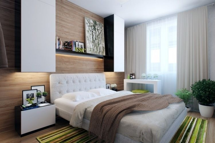 Holzwandverkleidung und weiße Schlafzimmermöbel - grüne Akzente - weise schlafzimmermobel gestaltungsideen
