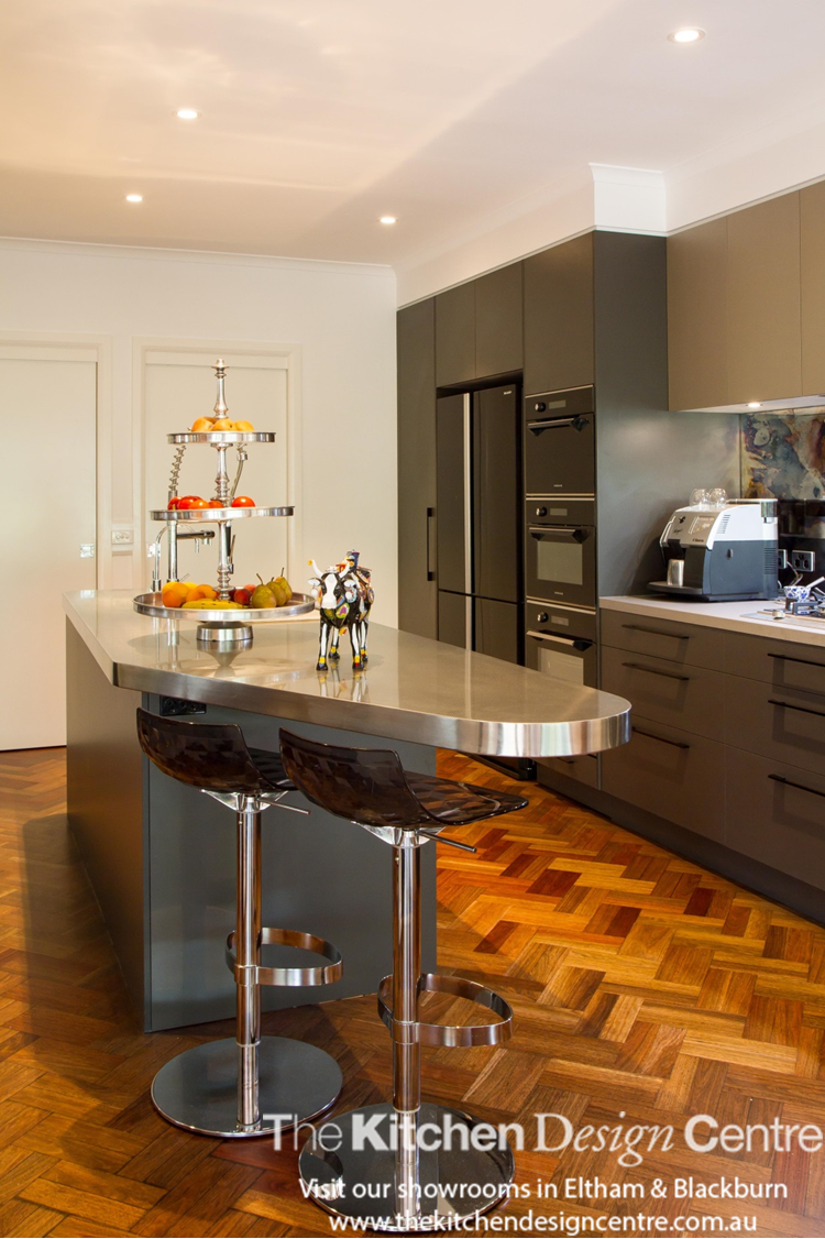 A moody kitchen designed as the perfect backdrop to a ...