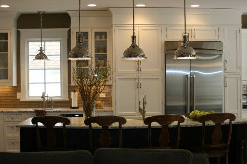 Above an island. When thinking of pendant lighting what probably comes to mind first are fixtures hung in a kitchen. They are a great solution for providing adequate task lighting while also providing an opportunity to enhance or reinforce the kitchen design. Typically pendants should be placed 28 to 34 inches above the countertop, or 72 inches above the floor.     The nickel fixtures are a wonderful choice here, repeating the classic spirit of the kitchen design. A smaller version of the…