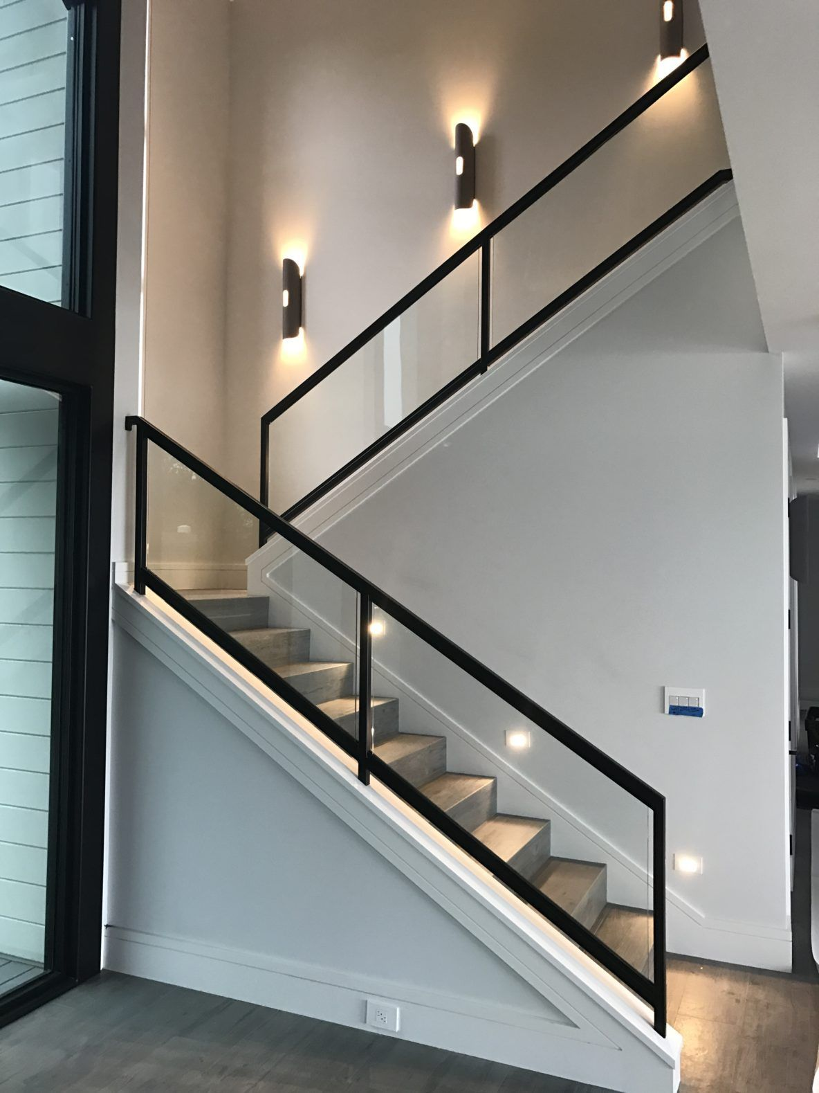 Steel And Wood Stairs With A Glass Handrail Lead Up To The | Wood And Glass Handrail