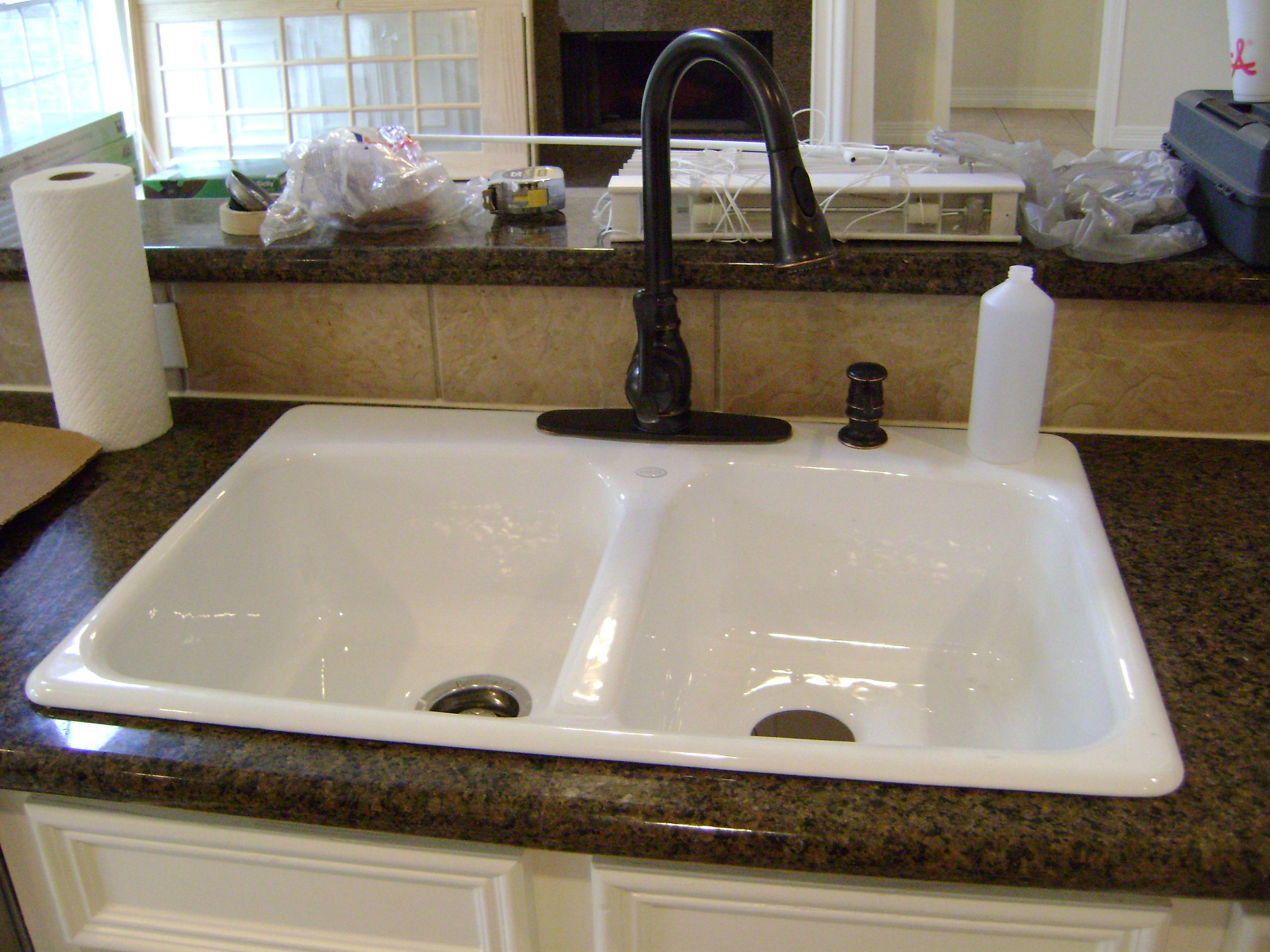 White Cabinets White Sink Bronze Hardware And Brown Neutral Counters Wall Mount Kitchen Faucet Kitchen Faucet With Sprayer Kitchen Sink Fixture
