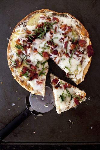 ABOVE LEFT: Roasted cherry tomato, caramelized onion, arugula and prosciutto pizza. ABOVE RIGHT: Yukon gold potato, bacon, ricotta and basil pizza.