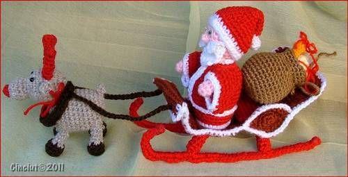 Santa, sleigh, and rudolf all crocheted