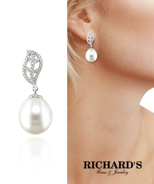 Freshwater pearl and diamond earrings in 18k white gold.