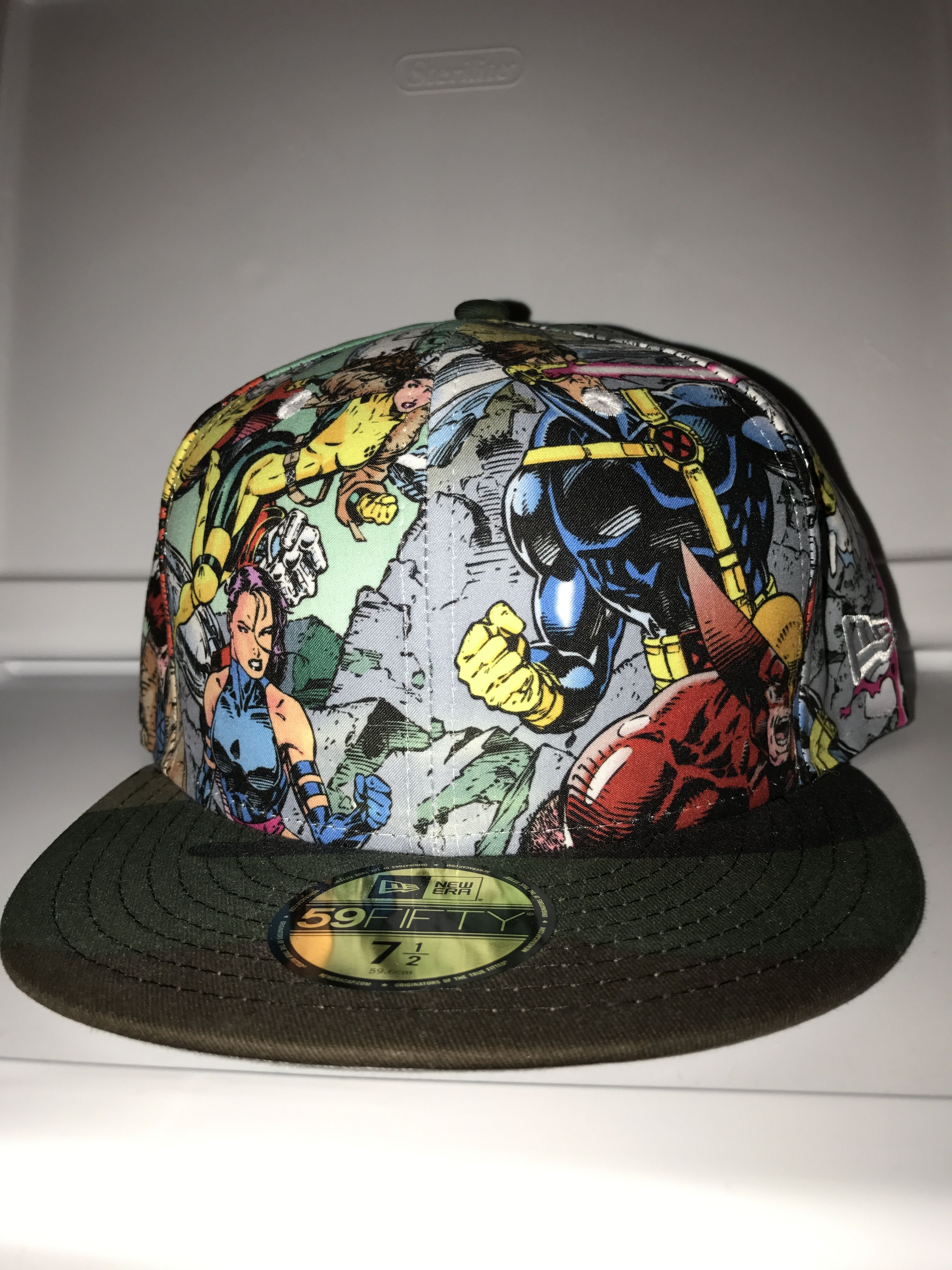 420d7cd80b9 New Era Marvel X-Men all over by Jim Lee with camouflaged brim   X symbol  on the back fitted