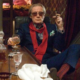 Bill Nighy style hero wearing a red scarf.