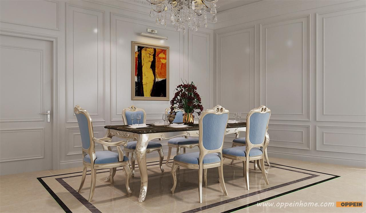 Golden and blue dinning table and chairs dinning room next to the kithcen