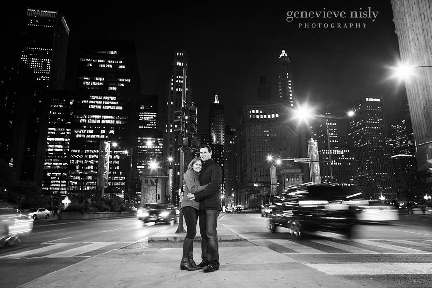 Couple on the median sidewalk while cars drive by during Chicago engagement session. Genevieve Nisly Photography