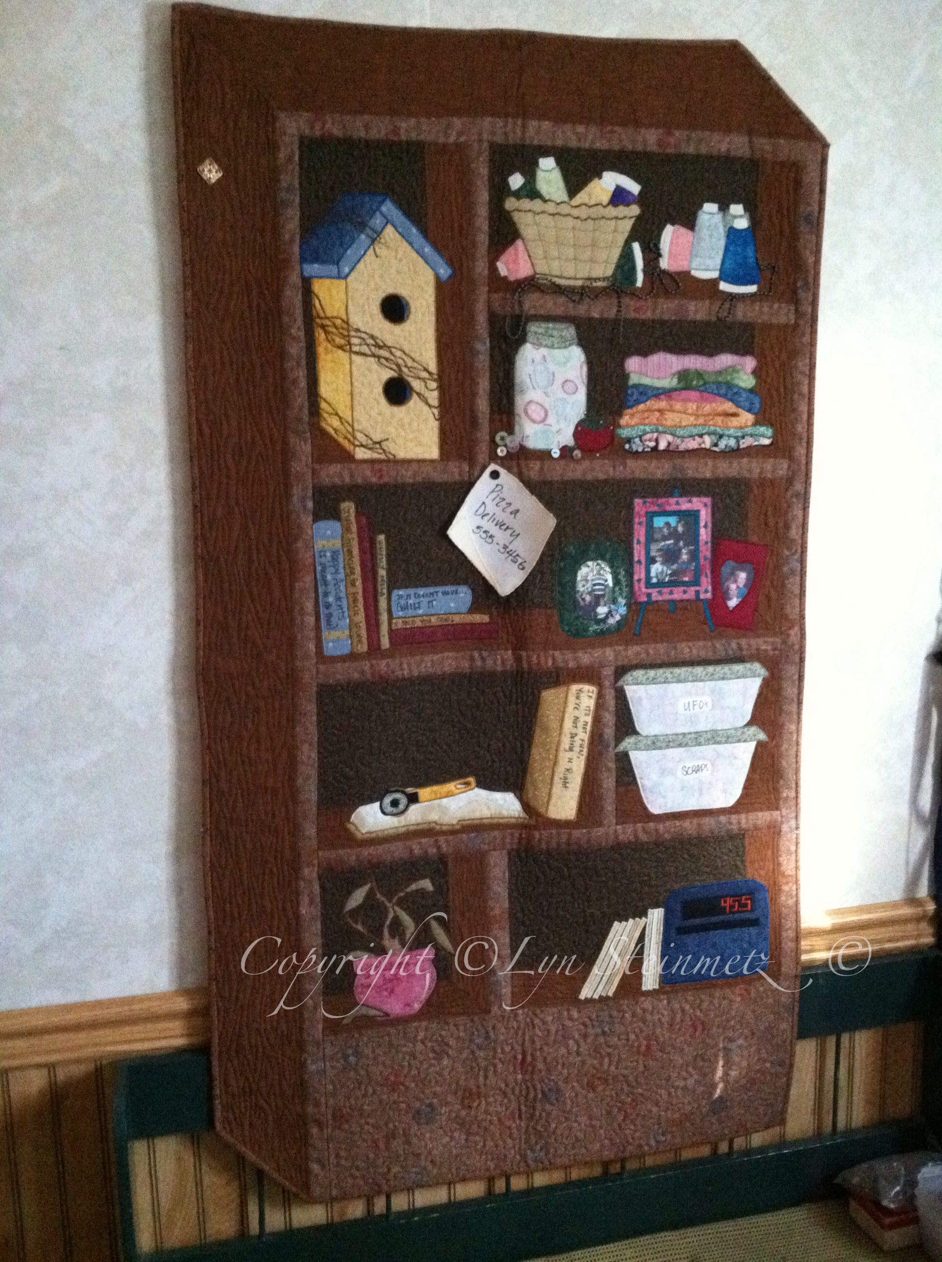 My bookcase quilt- right down to the dead plant.