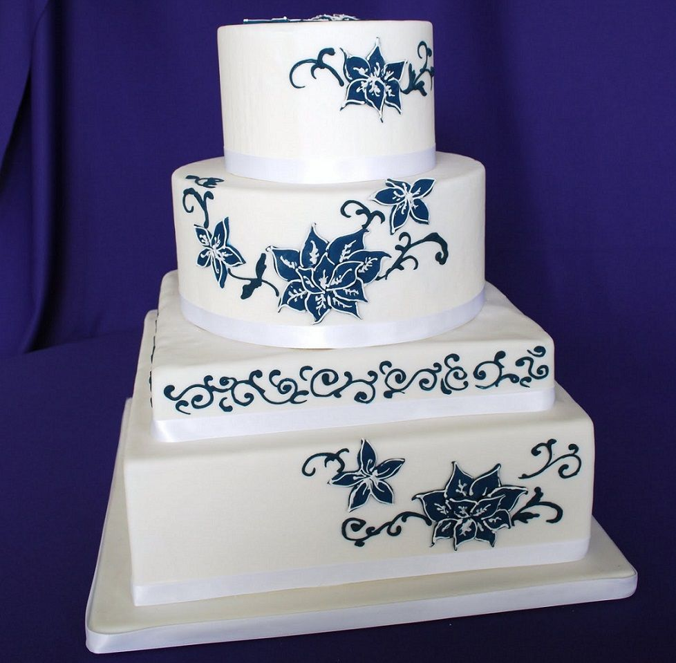 Four tier round and square white wedding cake decorated with blue four tier round and square white wedding cake decorated with blue flowers izmirmasajfo