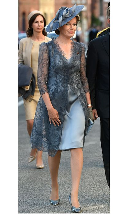 The Cambridges' host, Queen Mathilde of Belgium, looked elegant in a silk dress with lace jacket for a July 30 a ceremony marking the centenary of the battle of Passchendaele in Ypres.