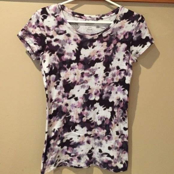 Multi-Colored T- Shirt Crew neck multi color t-shirt. Colors are purple, black, beige, white. Great condition! Daisy Fuentes Tops Tees - Short Sleeve
