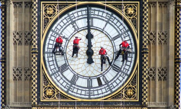 Abseilers cleaning Big Ben in London.   |   via @guardian