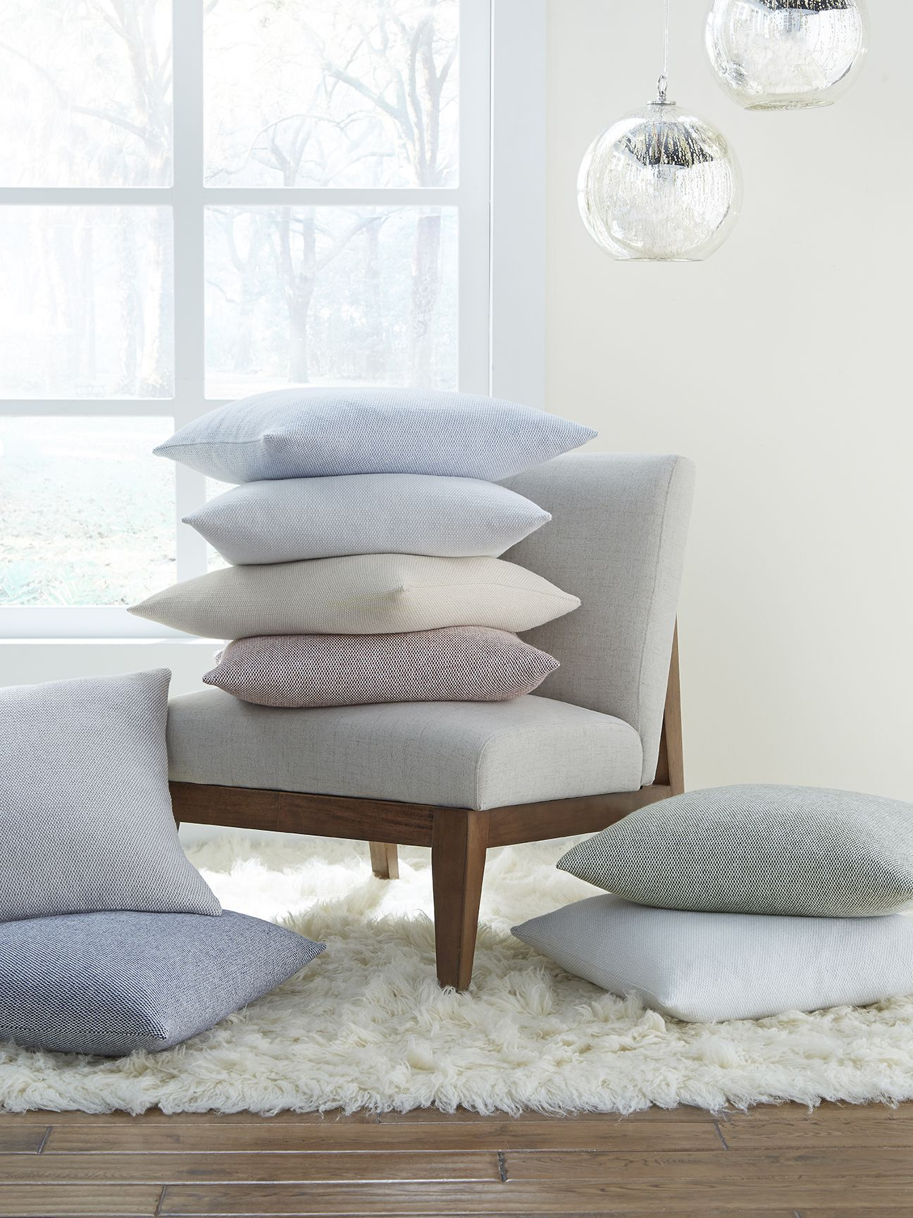 Terzo pillows and throws feature a classic basket weave pattern in soft, versatile colors that are welcoming in any room. Graceful and elegant, it is crafted from pure cotton and the pillows are filled with feather and down.