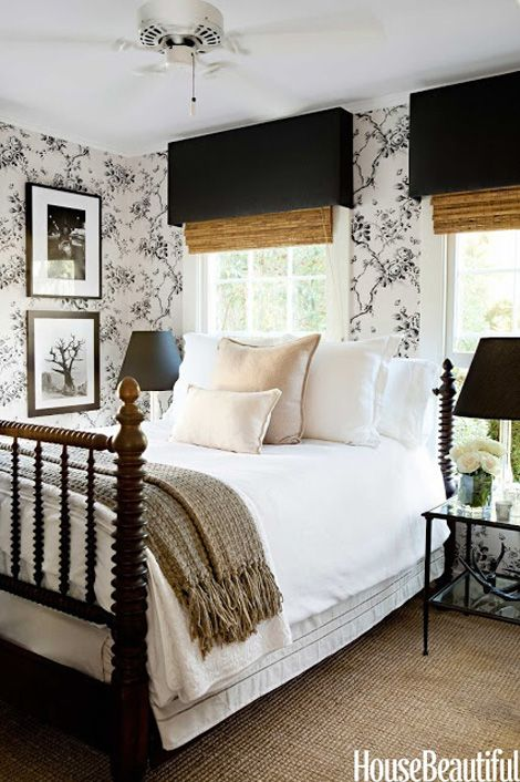 Charming bedroom with antique bed, bamboo blinds toile wallpaper