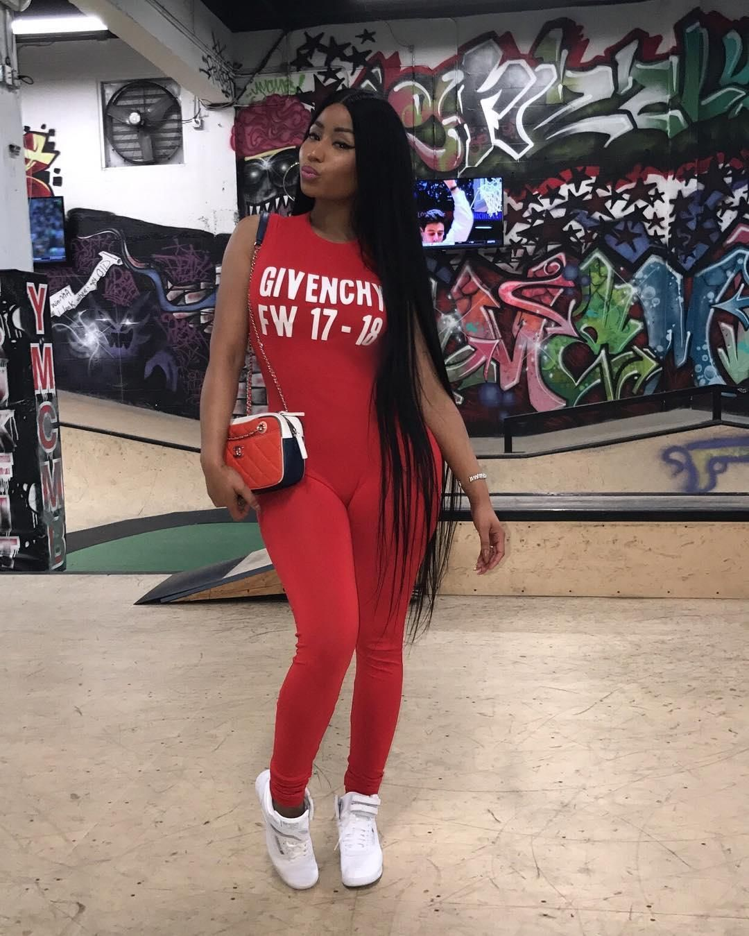 b50e8511dca3 Nicki Minaj shows her style at Lil Wayne s party wearing her Givenchy red  jumpsuit.